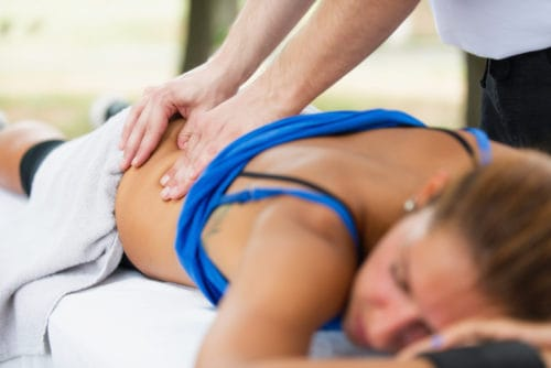 female athlete getting massage