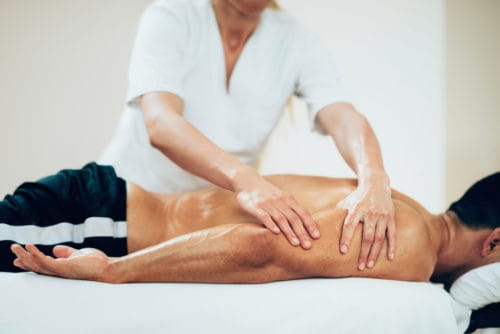 deep tissue massage on athlete
