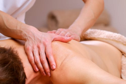 massage therapist working on client