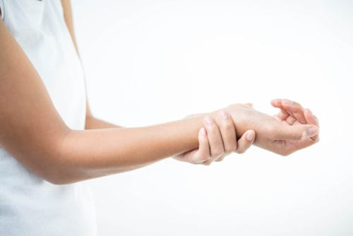 woman holding wrist because of the arthritis pain