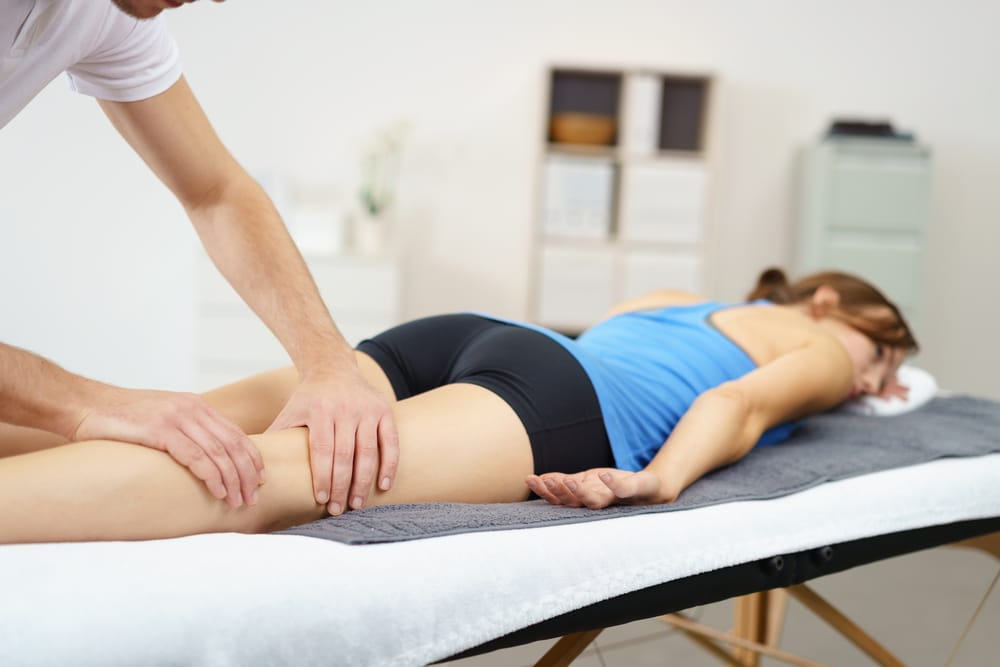 A licensed massage therapist works in a sports clinic.