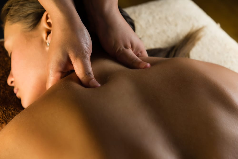 Woman enjoying an upper back massage.